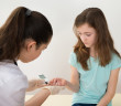 Doctor Measuring Blood Sugar Level Of Girl